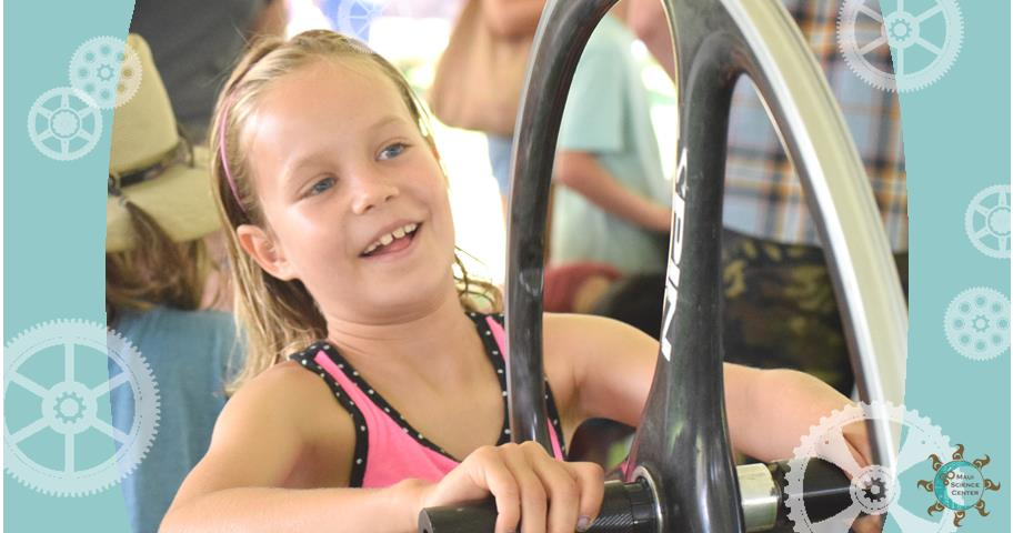 A Maui girl is testing bike-gyro at the Science carnival 2015, Kalama Park